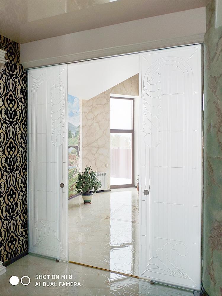 Сдвижные стеклянные двери